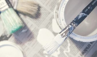 Paint and brushes for interior house painting DIY project