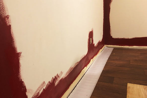 DIY accent wall painting the trim and borders