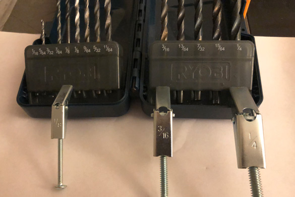 Toggle bolts wings and drill bits for fastening a DIY wall mounted coat rack
