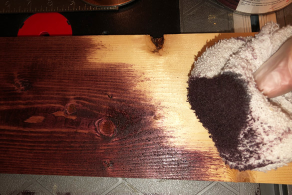 Application of wood stain to a DIY wall mounted coat rack