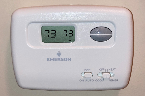 old analog thermostat with limited capabilities