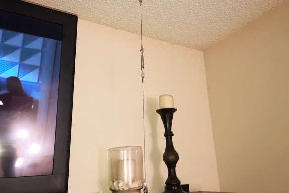 DIY wall mounted shelving with wire and turnbuckle support for extra weight